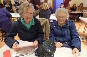 Filling in voting slips at South Mainland Decides